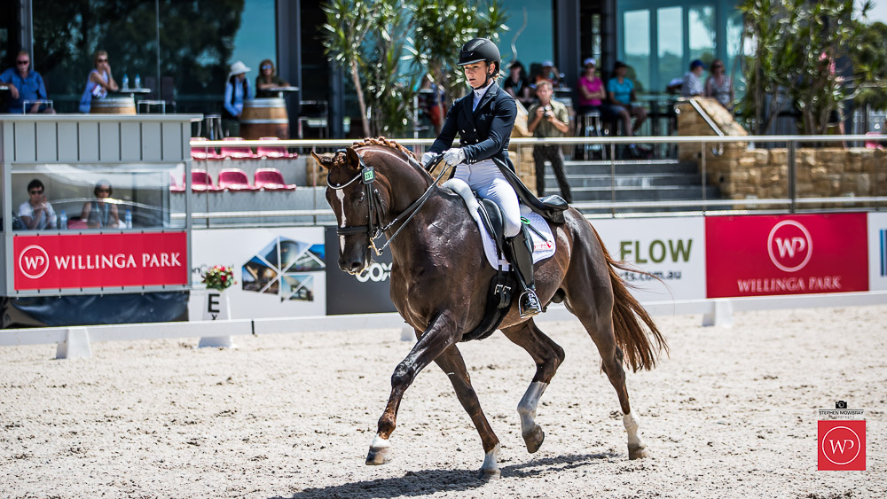 Alexis Hellyer and 'Bluefields Floreno' win the class with a score of 69.76%