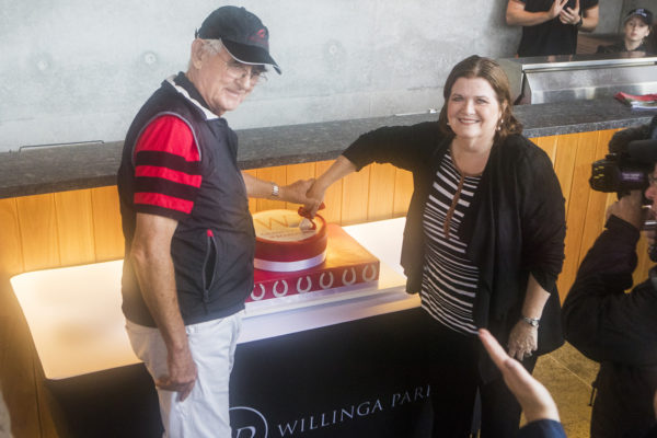 Terry Snow cutting the cake at Willinga Park grand opening