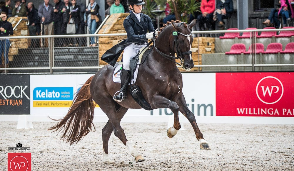 Alexis Hellyer and'Blufields Floreno' win the class with a score of 75.53%