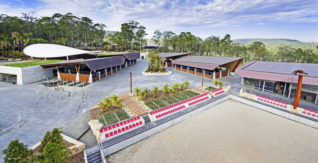 Wide lens shot of an arena and stables