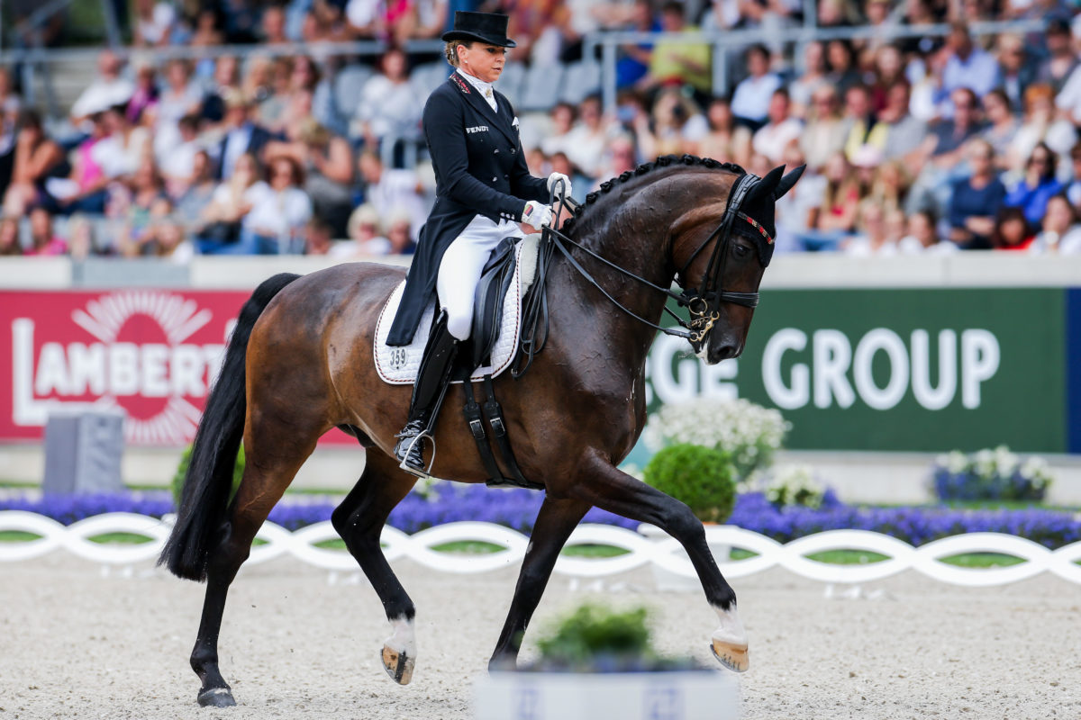Aachen, Germany. 18th July, 2019. CHIO, equestrian sport, dressage: The dressage rider Dorothee Schneider from Germany on the horse Showtime rides through the course. Credit: Rolf Vennenbernd/dpa/Alamy Live News